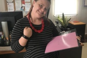 Sophie, our admin assistant showing her Fitbit.