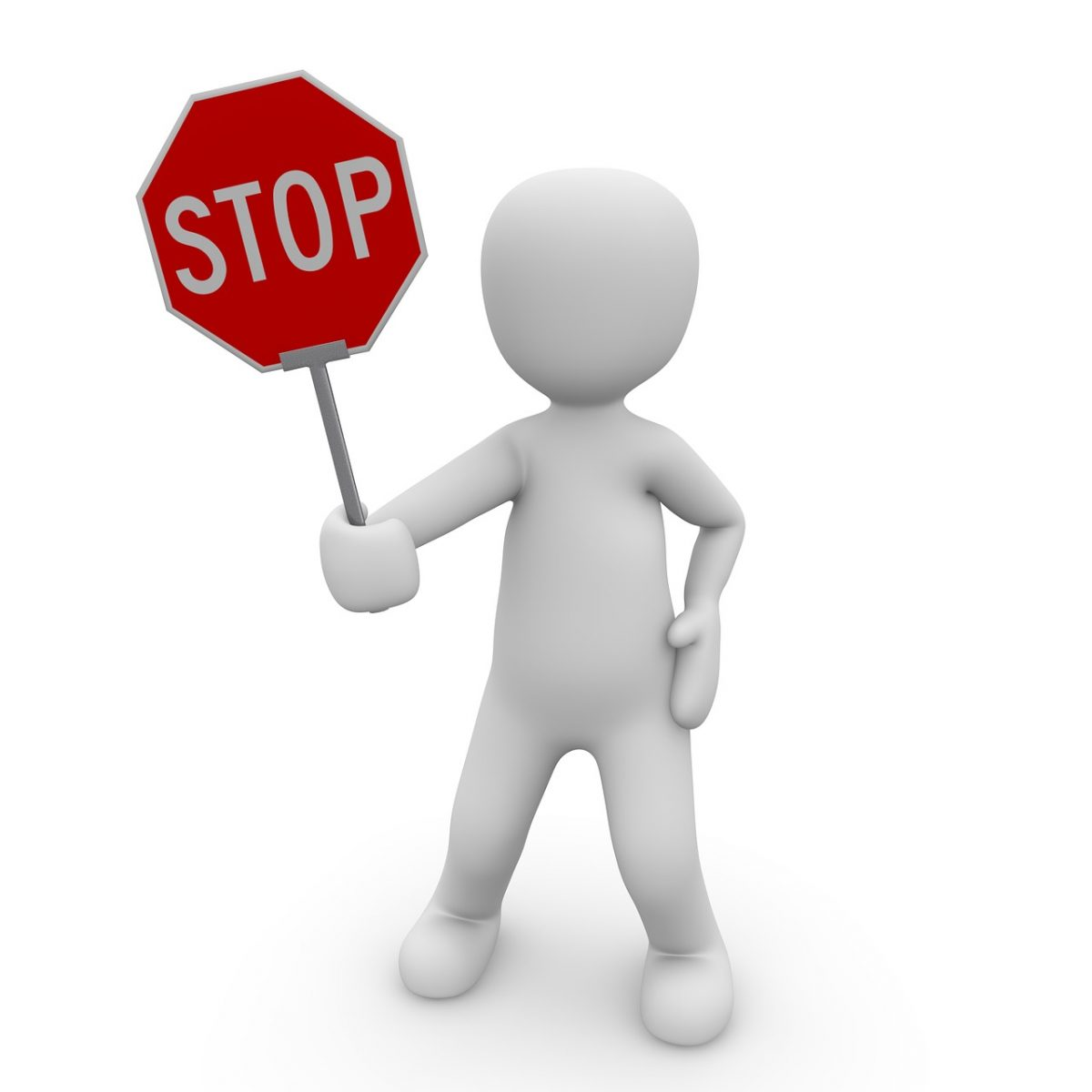 White clay-style person holding a stop sign