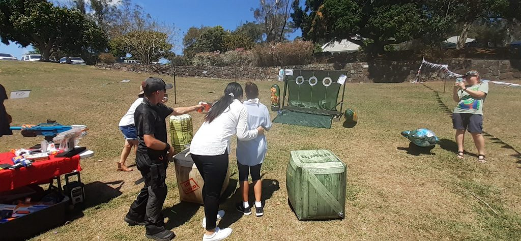A family having a go at NERF targets.