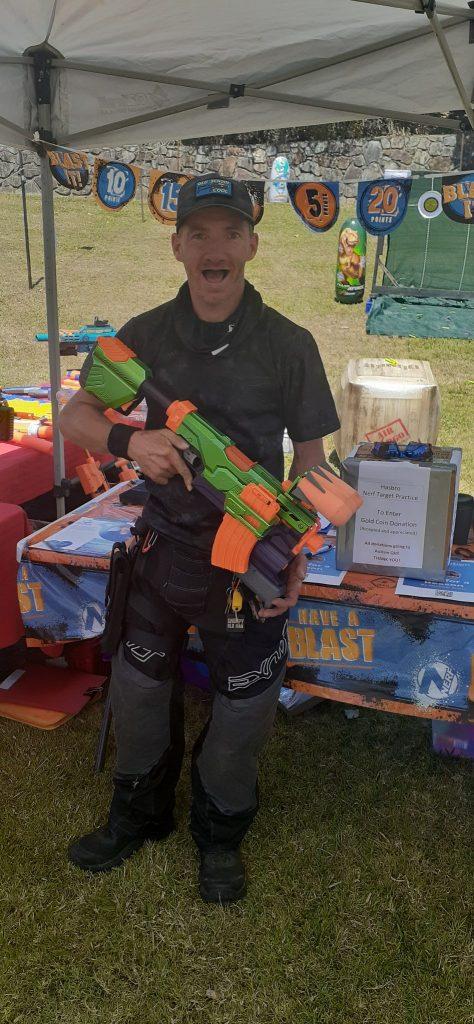 Photo of Michael holding a NERF gun.