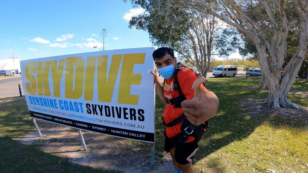 Bruno with a Sunshine Coast Skydivers banner.
